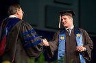 May 17, 2015; Football player Joe Schmidt receives his diploma from Mendoza College of Business Dean Roger Huang at the MCOB Undergraduate Degree ceremony. (Photo by Matt Cashore/University of Notre Dame)