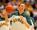 13 February 2011: University of Vermont Catamount forward Ryan McKeaney, a Freshman from Marlton, NJ, warms up prior to facing the Binghamton University Bearcats at Patrick Gymnasium in Burlington, Vermont. The Catamounts came from behind to defeat the Bearcats 60-51 in their America East matchup. The Cats took part in the National Pink Zone Breast Cancer Awareness Program by wearing special white jerseys with pink trim. The jerseys were auctioned off following the game with proceeds going to the Vermont Cancer Center. Mandatory Credit: Ed Wolfstein Photo
