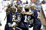 23 April 2016: Notre Dame's Kyle Trolley (CAN) (19) is mobbed by teammates after scoring a goal. The University of North Carolina Tar Heels hosted the University of Notre Dame Fighting Irish at Kenan Stadium in Chapel Hill, North Carolina in a 2016 NCAA Division I Men's Lacrosse match. UNC won the game 17-15.