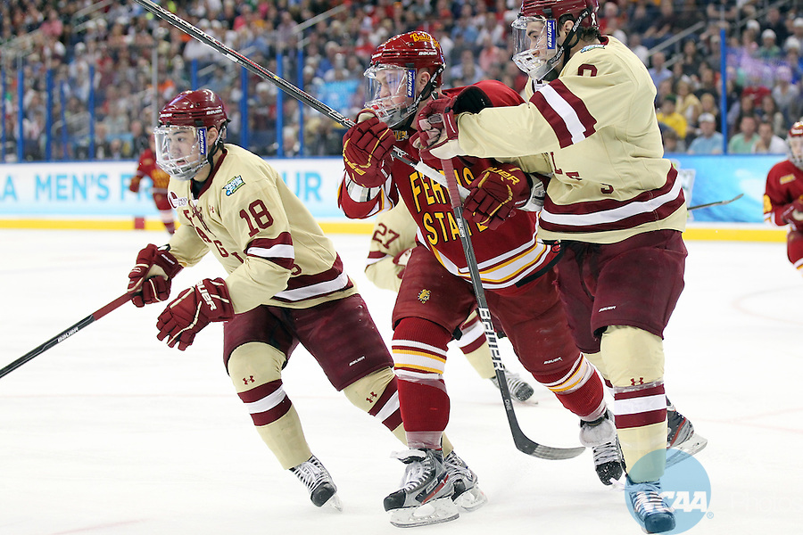 07 APR 2012:  Edwin Shea (8) of Boston College and TJ Schlueter (12) of Ferris State University clash on the ice during the Division I Men's Ice Hockey Championship held at the Tampa Bay Times Forum in Tampa, FL.  Boston College defeated Ferris State 4-1 to win the national title.  Matt Marriott/NCAA Photos