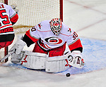 21 December 2008: Carolina Hurricanes' goaltender Cam Ward makes a save on Montreal Canadiens' right wing forward Matt D'Agostini in the first period at the Bell Centre in Montreal, Quebec, Canada. The Hurricanes defeated the Canadiens 3-2 in overtime. ***** Editorial Sales Only ***** Mandatory Photo Credit: Ed Wolfstein Photo