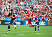 August 21 2010 New York Red Bulls forward Juan Pablo Angel # 9 and Toronto FC defender Nick Garcia #4 in action during a game between the New York Red Bulls and Toronto FC at BMO Field in Toronto..The New York Red Bulls won 4-1.