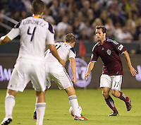 Brian Mullan of the Colorado Rapids moves with the ball in front of advancing LA Galaxy players Chris Birchall and Omar Gonzalez. The Colorado Rapids defeated the LA Galaxy 3-1 at Home Depot Center stadium in Carson, California on Saturday October 16, 2010.