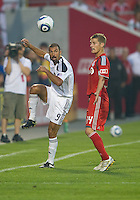 26 June 2010: Toronto FC defender Raivis Hscanovics #34 and Los Angeles Galaxy forward Jovan Kirovski #9 in action during a game between the Los Angeles Galaxy and the Toronto FC at BMO Field in Toronto..Final score was 0-0...
