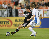 Stephen King #20 of D.C. United fires off a shot past Christopher Leitch #3 of the San Jose Earthquakes during an MLS match at RFK Stadium in Washington D.C. on October 9 2010. San Jose won 2-0.