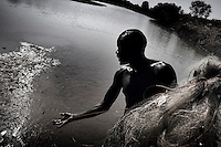 South Sudan. 18 March 2011...Fishermen along the banks of the river Jur, a Nile tributary, in the state of western Bahr el Ghazal..