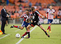 Perry Kitchen (13) of D.C. United fights for the ball with Nick LaBrocca (10) of Chivas USA during the game at RFK Stadium in Washington, DC.  D.C. United defeated Chivas USA, 1-0.