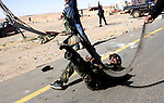 A Libyan rebel throws himself to the ground while firing at an aircraft flown by a government loyalist above Ras Lanuf. Fierce clashes erupted as the rebels advanced in fits and starts toward the capital, Tripoli.