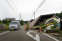 Buildings damaged by the March 2011 earthquake and left unprepared. Namie, Fukushima Prefecture, Japan, August 2, 2013. The town of Namie was evacuated following the nuclear accident of March 2011. Residents can only return for short periods to tend to their former homes and pick up belongings, and are not permitted to stay overnight.