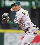 Oakland Athletics second baseman Adam Rosales gets set to throw to first base against  the Seattle Mariners in the opening home game of the season at SAFECO Field in Seattle April 12, 2010. The Athletics beat the Mariners 4-0. Jim Bryant Photo. &copy;2010. ALL RIGHTS RESERVED.