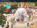People being splashed with water at a water park's pump house at Canada's Wonderland amusement park. Vaughan, Ontario, Canada 2011.