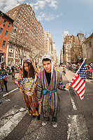 """Marchers perform a """"mock-wedding"""" dressed in traditional wedding attire in the 11th annual Persian Parade on Madison Ave. in New York on Sunday, April 13, 2014. The parade celebrates Nowruz, New Year in the Farsi language. The holiday symbolizes the purification of the soul and dates back to the pre-Islamic religion of Zoroastrianism. (© Richard B. Levine)"""