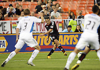 Carlos Verela #11 of D.C. United shoots between Christopher Leitch #3 and Jason Hernandez #21 of the San Jose Earthquakes during an MLS match at RFK Stadium in Washington D.C. on October 9 2010. San Jose won 2-0.