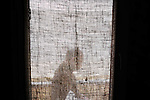 A worker walks by a window wrapped in burlap at KAIA (Kabul International Airport) in Afghanistan.
