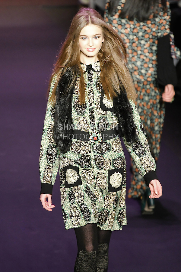 Kristina Romanova walks runway in an outfit from the Anna Sui Fall 2011 collection, during Mercedes-Benz Fashion Week Fall 2011.
