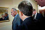 "Senate Rules and Administration Chairman CHUCK SCHUMER (D-NY) confers with Senator AL FRANKEN (D-MN) following a news conference on Capitol Hill Wednesday to announce new legislation ""to blunt the worst effects"" of the Supreme Court's Citizens United v. Federal Election Commission decision."