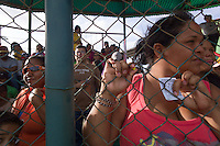 Locals listen for numbers during a community bingo game at the local baseball stadium in Pueblo Nuevo on Venezuela's Paraguaná Peninsula, Dec. 13, 2015. The remote desert peninsula in the Caribbean Sea lays bare the effects of Venezuela's politicized economy after 17 years under Hugo Chavez and successor Nicolas Maduro. Contestants filled in bingo sheets in hopes of some cooking oil or bread.