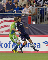 New England Revolution midfielder Marko Perovic (29) controls a pass as Seattle Sounders FC defender Jeff Parke (31) closes. The New England Revolution defeated the Seattle Sounders FC, 3-1, at Gillette Stadium on September 4, 2010.