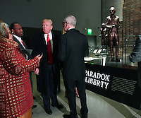United States President Donald Trump visits the Smithsonian National  Museum of African American History and Culture in Washington, DC on February 21, 2017.  The &quot;Paradox of Liberty&quot; exhibit at right shows President Thomas Jefferson with his slaves, each brick being a slave.<br />  Credit: Kevin Dietsch / Pool via CNP /MediaPunch