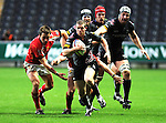 Jamie Nutbrown breaks through the Worcester defence. Ospreys V Worcester Warriors, EDF Energy Cup  © Ian Cook IJC Photography iancook@ijcphotography.co.uk www.ijcphotography.co.uk