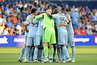 Sporting KC players in a huddle prior to the game... Sporting KC defeated Vancouver Whitecaps 2-1 at LIVESTRONG Sporting Park, Kansas City, Kanas.