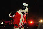 Chik-Fil-A cow rides in the Christmas parade in Oxford, Miss. on Monday, December 6, 2010.