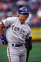 OAKLAND, CA - Jose Canseco of the Toronto Blue Jays bats during a game against the Oakland Athletics at the Oakland Coliseum in Oakland, California in 1998. Photo by Brad Mangin