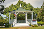 Small town Gazebo on village green. Signage for concerts.