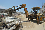 Heavy equipment is used to break up rubble in Shejaiya, a neighborhood of Gaza City that was hard hit by the Israeli military during the 2014 war. Much of the rubble in Gaza is recycled into new building materials.