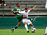 13 September 2009: University of Vermont Catamount midfielder Dwayne Dove, a Freshman from Turnersville, NJ, battles University of Massachusetts Minutemen midfielder Bryant Craft, a Sophomore from Worcester, MA, during the second round of the 2009 Morgan Stanley Smith Barney Soccer Classic held at Centennial Field in Burlington, Vermont. The Catamounts and Minutemen battled to a 1-1 double-overtime tie. Mandatory Photo Credit: Ed Wolfstein Photo