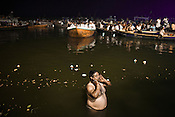 A pilgrim looks on after taking a holy dip in the ganges at the Dashashwamedh Ghat in the ancient city of Varanasi in Uttar Pradesh, India. Photograph: Sanjit Das/Panos
