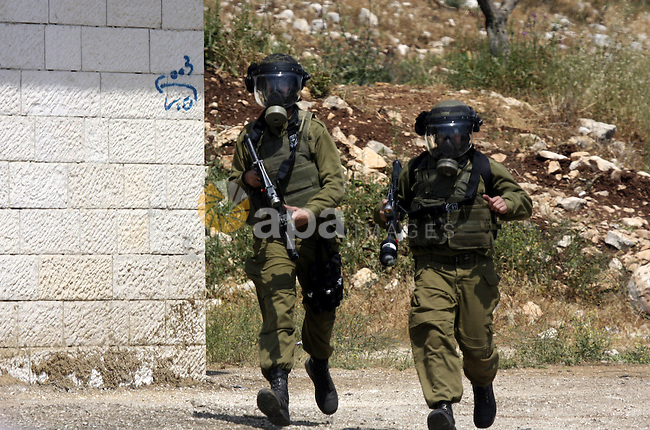 Israeli soldiers fire teargas canisters against Palestinian protesters as they demonstrate against the expropriation of Palestinian land by Israel in the village of Kafr Qaddum, near the northern city of Nablus in the occupied West Bank, on April 20, 2012.  Photo by Wagdi Eshtayah
