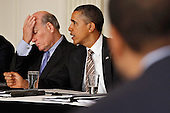United States President Barack Obama (R) meets with his Council on Jobs and Competitiveness, a group of business leaders tapped to come up with job-spurring ideas, with White House Chief of Staff William Daley in the State Dining Room at the White House January 17, 2012 in Washington, DC. Headed by General Electric CEO Jeffrey Imelt, the council released a report with suggestions, including investment in education and research and development, support for the manufacturing sector and reform in the tax and regulatory systems.  .Credit: Chip Somodevilla / Pool via CNP