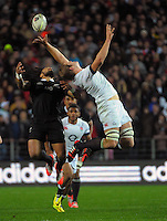 Joe Launchbury (right) and Ma'a Nonu compete for high ball during the Steinlager Series international rugby match between the New Zealand All Blacks and England at Waikato Stadium, Hamilton, New Zealand on Saturday, 14 June 2014. Photo: Dave Lintott / lintottphoto.co.nz
