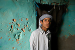 A young Siwan man stands inside his home in the Siwa Town of the Siwa Oasis near the Libyan border in Egypt.