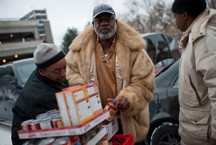 UNITED STATES - FEBRUARY 12:  Church goers gather donated food before a Sunday service at Mt. Zion Congregational Church in Cleveland, Ohio. (Photo By Tom Williams/CQ Roll Call)