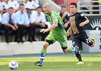 Roger Torres #20 of the Philadelphia Union falls behind Freddie Ljungberg #10 of the Seattle Sounders FC during the first MLS match at PPL stadium in Chester, PA. on June 27 2010. Union won 3-1.
