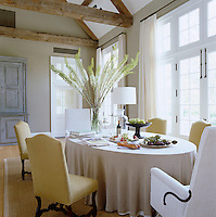 The oval table in the open-plan kitchen dining area seats six in comfortable upholstered chairs