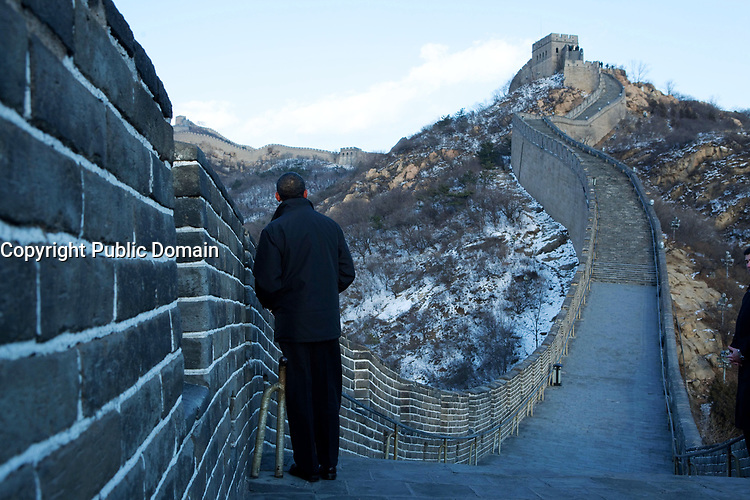 President Barack Obama tours the Great Wall in Badaling, China, Nov. 18, 2009. (Official White House Photo by Pete Souza)<br /> <br /> This official White House photograph is being made available only for publication by news organizations and/or for personal use printing by the subject(s) of the photograph. The photograph may not be manipulated in any way and may not be used in commercial or political materials, advertisements, emails, products, promotions that in any way suggests approval or endorsement of the President, the First Family, or the White House.