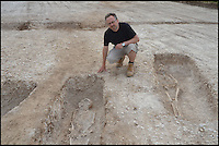 BNPS.co.uk (01202 558833) <br /> Pic: BournemouthUniversity/BNPS<br /> <br /> Dr Miles Russell at the Winterbourne Kingston Archaelogical dig. <br /> <br /> <br /> A group of first year university students have made one of the most significant archeological finds of recent times after discovering the 1,700-year-old remains of a wealthy Roman family.<br /> <br /> The budding archaeologists discovered a grave containing five super-rich Romans in a farmer's field in rural Dorset just metres from where a 4th century villa was found.<br /> <br /> Although more than 700 Roman villas have been found in Britain, it is the first time ever the people who lived in them have been uncovered.<br /> <br /> Experts have described the find as &quot;hugely significant&quot; - and say it could provide vital clues to who was living in Britain around 350 AD.<br /> <br /> Around 85 students, mostly aged in their late teens and early 20s, made the landmark discovery after carrying out a study on a corn field near Winterbourne Kingston near Blandford in Dorset.