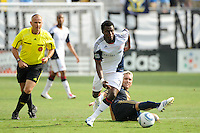 Kenny Mansally (7) of the New England Revolution gets past a fallen Eduardo Coudet (21) of the Philadelphia Union. The Philadelphia Union and the New England Revolution  played to a 1-1 tie during a Major League Soccer (MLS) match at PPL Park in Chester, PA, on July 31, 2010.
