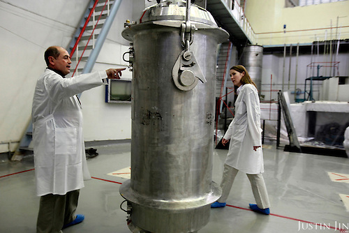 Physicist Igor Bolshinsky and project leader Kelly Cummins inspect a cask containing highly enriched uranium at the Institute of Nuclear Physics in Almaty, Kazakhstan. .Bolshinsky is pointing at an IAEA (International Atomic Energy Agency) seal that verifies the authenticity of the nuclear shipment. The removal of Kazakhstan's highly enriched uranium (HEU) is part of the U.S. Global Threat Reduction Initiative (GTRI), where Bolshinsky and Cummin work, that tries to secure nuclear material around the world to prevent their misuse by terrorists and rogue states.