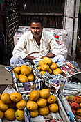 A mango vendor at the whole sale fruits and vegetable market in Azadpur Mandi in Old Delhi, India. Photo: Sanjit Das/Panos for Time