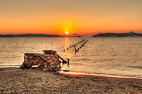 Sunset at a ruined bridge in Alikes of Milos, Greece