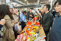 Workers from Bokksu, a Japanese snack subscription start-up, speak to attendees at the TechDay New York event on Tuesday, April 18, 2017. Thousands attended to seek jobs with the startups and to network with their peers. TechDay bills itself as the U.S.'s largest startup event with over 500 exhibitors. (© Richard B. Levine)