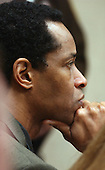 Sniper suspect John Allen Muhammad listens to court proceedings in courtroom 10 at the Virginia Beach Circuit Court in Virginia Beach, Virginia on November 17, 2003 during the second day of jury deliberations in Virginia Beach. <br /> Credit: Dave Ellis - Pool via CNP