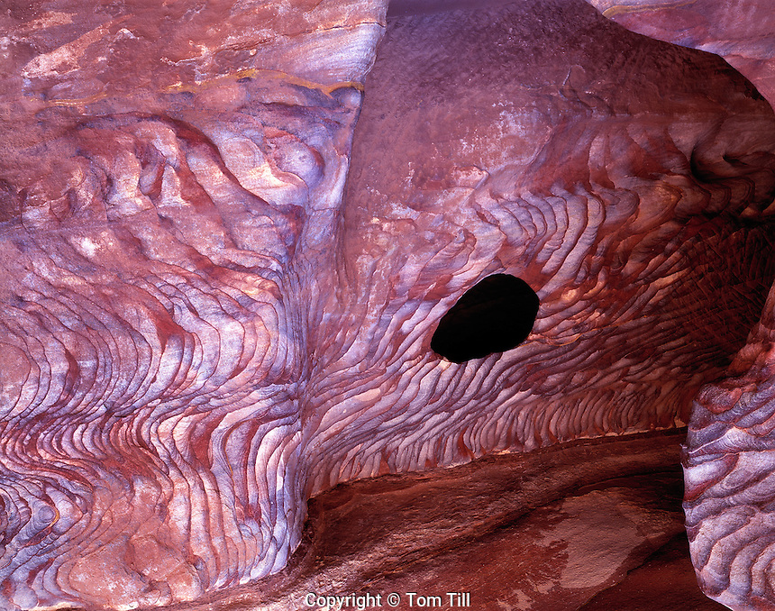 Nubian Sandstone, Moab, Petra, Jordan   Brilliantly patterned sandstone detail with rock cave   Petra National Park