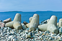 Saltee Islands in Irish Sea with sea defences in foreground, Kilmore, County Wexford, Ireland