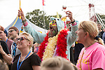 Electric Fields music festival at Drumlanrig Castle, Dumfries and Gallloway Scotland. Colonel Mustard on stage, dressed up character in crowd