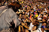 A Peruvian actor Mario Valencia, performing as Jesus Christ, greets catholic followers at the end of the Good Friday procession during the Holy week in Lima, Peru, 30 March 2013. The annual Passion Of Christ procession, held as part of Easter celebrations, starts in Lima downtown and, followed by thousands of catholic believers, it climbs to the top of the dry and rocky hill of San Cristobal, where Mario Valencia, who has been playing the role of Jesus Christ for more than 30 years, is symbolically crucified.